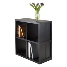 #manythings The Timothy #Collection brings modernistic perspectives into the design of our all #wood products. The Timothy 2 x 2 shelving units have compartments ...