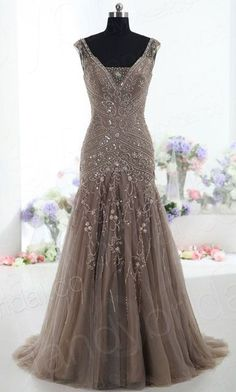 This gown speaks beauty and elegance with its detailed lace and beading embellishments along the entire frame. Gorgeous!