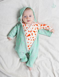 Noe & Zoe with their bright orange triangles and unisex green. Love this baby's gear!