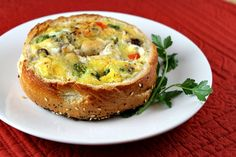 Recipe for a Bagel Quiche- a quiche filling made inside of a hollowed out bagel.