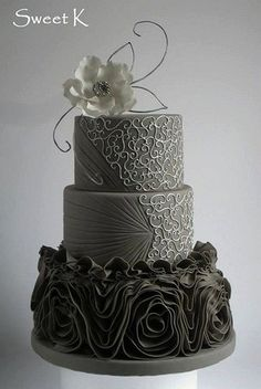 This ruffle cake was designed after a dress with the first and second tiers made from royal icing. Follow us @SIGNATUREBRIDE on Twitter and on FACEBOOK @ SIGNATURE BRIDE MAGAZINE