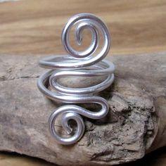Deep waves silver ring aluminium anodized. $8.00, via Etsy.