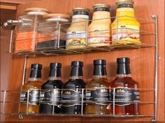 JP Spice Rack         JPD 2 Tier Spice Rack. Simply mounted to the rear of the door, the 2-tier rack provides useful storage for small bottles and jars. Dimensions: Width: 395mm, Depth: 100mm, Height: 406mm