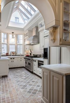 Traditional Kitchen with limestone tile floors, Ceramic Tile, Exposed beam, U-shaped, Complex marble counters, Skylight