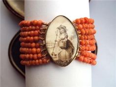 Georgian sepia navette pin featuring shepherdess with 8 strand coral bracelet. c1780