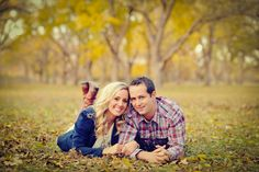 cute fall picture engagement idea, caleb wearing plaid