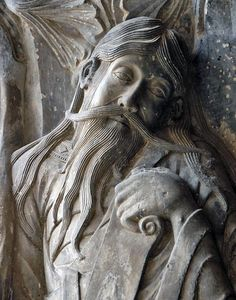 Early Gothic period - The weeping prophet, Jeremiah. Statuary detail from a pillar in the cloisters of the Abbaye St-Pierre de Moissac, Moissac France, 12th century.