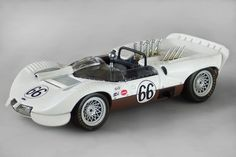 1965, late season Chaparral 2 in 1/43 scale by AutoArt. This model is of the Museum car. As raced in this configuration it was Chassis 2-001. Jim Hall never raced with this rear spoiler configuration. Hap Sharp did at Laguna Seca, 9/25/65. Thus, it would be more accurate if numbered # 65 rather than # 66. From Antonio's blog.... https://www.blogger.com/profile/09553201116629954649