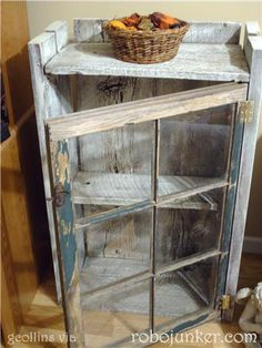Old window and barn wood combine to make a cupboard.