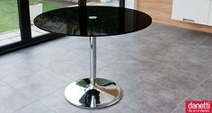 The Naro Black Glass Cafe Table has a simple modern design which draws attention to the stylish chrome trumpet base. The 12mm thick black glass table top measures 1000mm in diameter making it perfect for any modern setting and suitable for up to four people.  £267.00