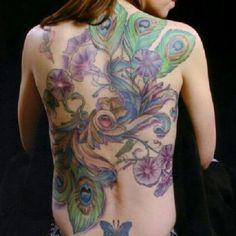 Backpiece; back; peacock; floral; flower; purple; trumpet flower; angel trumpet flower; abstract; tattoo by Johnny Jinx at Broken Clover in Tucson, AZ