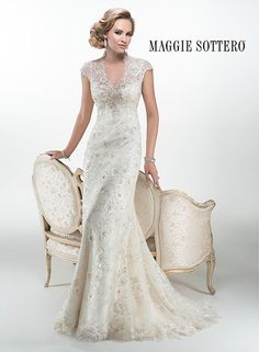 Stunning beaded embroidered lace wedding dress with illusion cap-sleeves. Odette by Maggie Sottero.