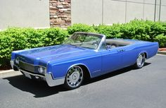 Fully Custom Restored 1967 Lincoln Continental Convertible. This car was built by Troy Trepanier at Rad Rides by Troy for former Red Sox/Dodgers Slugger Manny Ramirez. Over $200,000 was spent on this frame-off restoration project. The Continental had both interior and exterior custom work, making it a true one of a kind. It is finished in Neptune Blue, which is a Bentley Motors Factory Color. No expense was spared in creating the ultimate 4-Door Convertible.