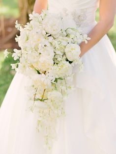 White cascade bouquet with orchids, peonies and lisianthus