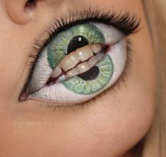 Two eyes not enough for you? Try this freaky lip design from Psycho Sandra. She created the lip look using cream makeup and a set of falsie lashes. Follow her tutorial, slip into your costume, and you'll have all eyes on you.