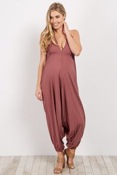 We've fallen in love with this bohemian style harem jumpsuit. On trend and ultra comfy this maternity jumpsuit will be your new favorite for this summer season. Style this beauty with a light jacket and sandals for a complete casual look.