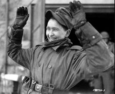 A young German paratrooper of the 3rd Parachute Division (German 3th Fallschirmjäger Division) smiles as he surrenders to American troops of the  16th Infantry Regiment, 1st Infantry Division, in Belgium. A large number of his division had surrendered during the later stage of the Battle of the Bulge. This particular youth seems happy that for him, at least, the risk of injury or death is now over. Weywertz, Liège, Wallonia, Belgium. 15 January 1945. Division, Paratrooper, North Africa, American, Troops, Belgium, Battle, January, German
