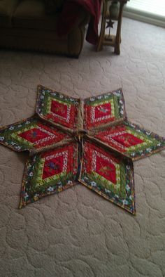 Log Cabin Style Christmas Tree Skirt With Embroidered Centers