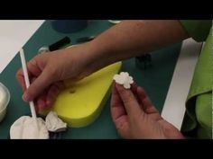 Minette Rushing, owner of Custom Cakes in Savannah GA, shows you step by step how to make your own cherry Blossoms out of gumpaste.  Here is a list of whats used:  Pallet Knife Dresden Tool Small Cel Stick 26 Gauge White Wire Cel Pad (With Holes) 3 Piece Cherry Blossom Cutter Set  Micro Stamens Corn Starch Pouch Shortening  Floral Tape (Both Wh...
