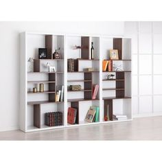 @Overstock - This Bart display shelf features beautiful contrasting finishes for a sleek, modern look. This versatile bookshelf also works well as a room divider and can stand either horizontally or vertically.http://www.overstock.com/Home-Garden/Bart-Multi-tiered-Modern-Display-Bookshelf/5328392/product.html?CID=214117 CAD              249.25