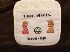 Mario Princesses cross stitched potholder on Etsy, $12.00