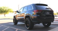 "Jeep Grand Cherokee with a 2.5 inch lift kit 32"" Tires and wheel spacers."