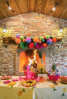 Love the pom cluster above the fireplace