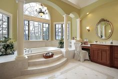 Large custom bathroom design with elevated tub room surrounded by windows.