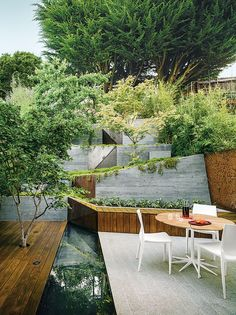 modern landscaping terrace pie deck reflecting pool granite patio. This Japanese-style yard in Berkeley, California might appear larger than it is, but that's all due to the illusion created by extending the garden design upward against the hillside.