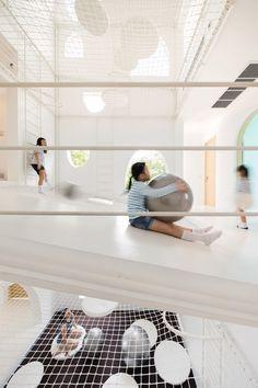 House in Thailand built around an indoor playground.