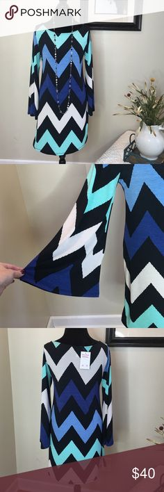 Adorable Chevron print dress Chevron print wide sleeve dress. 100% made in the USA!! 95% polyester and 5% spandex. Quality made dress!!! When I wore mine I received so many compliments!💋❤️💋🎉 The Blossom Apparel Dresses Midi