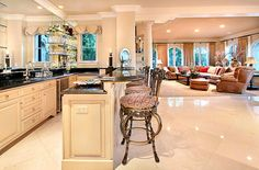 I love the open space of this kitchen/living room/dining room...!
