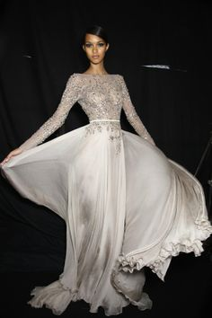 Elie Saab-one of my favorite designers...love how he uses textures and tons of fabric but still makes it look light, soft, ethereal. He is amazing-stunning creations.