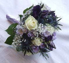 navy and purple weddings | The grooms-men each wore a single ivory rose with eryngium.