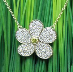 Daisy pendant in 14 karat yellow gold with white and yellow diamonds.