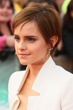 Emma Watson....wish I could figure out how to style my hair like this.