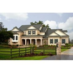 HousePlans.com 61-134...liking the outside look of this house...Black roof, white stone & brick...