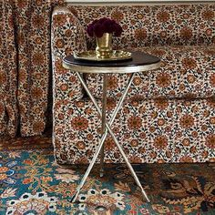 Soane Britain's hand beaten Tripod Table, with three interlocking legs with hooved feet, shown here with new Beaton Sofa upholstered in Persian Flower Upholstered Sofa, Of Wallpaper, Repeating Patterns, Stripes Design, Slipcovers, Persian, Britain, Armchair, Cushions