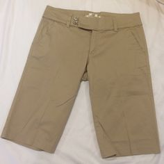 Re-posh! Old Navy khaki shorts. Like new condition. Super cute trim and button detail. Worn and washed by original posher a couple of times, never dried in dryer. Just a bit too small on me. 12 1/2 inch inseam. Old Navy Shorts