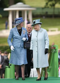 Queen Elizabeth II talks to Sarah Goad as the Magna Carta Commemoration Monument is seen in the background at a Magna Carta 800th Anniversary Commemoration Event on June 15, 2015 in Runnymede, United Kingdom.