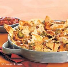 Gooseberry Patch Recipes:  Ultimate Nachos. Lots of cheese, spicy jalapeños and creamy refried beans!