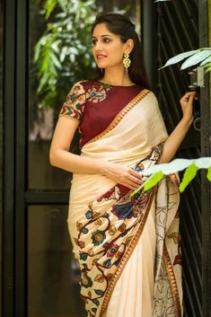 Cream Crepe Saree with handpainted kalamkari cross pallu applique border is paired with contrast maroon raw silk kalamkari blouse. This saree is from House of Blouse. Trendy Sarees, Stylish Sarees, Kalamkari Saree, Lehenga Choli, Kasavu Saree, Kalamkari Blouses, Kerala Saree Blouse, Sabyasachi Sarees, Silk Blouses