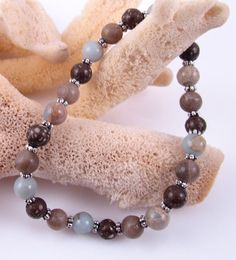 Michigan and African stones combined into stretchy bracelet by rwilberg