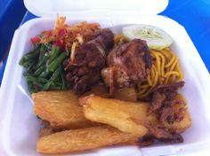 Surinam Food! Chicken with fried cassava, bami goreng, fried fish and asparagus beans. Hmmm