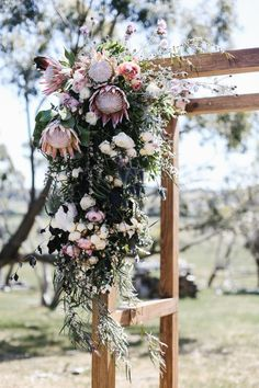 & Dylan's Chilled Barn Wedding native flower wedding arbour - obsessing over proteas, want them mixed with peonies and/or chrysanthemumsnative flower wedding arbour - obsessing over proteas, want them mixed with peonies and/or chrysanthemums Protea Wedding, Floral Wedding, Boho Wedding, Wedding Bouquets, Wedding Ceremony, Dream Wedding, Trendy Wedding, Wedding Rustic, Wedding Rings