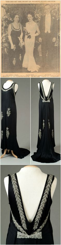 Striped black satin crepe evening gown accented with rhinestone beaded grape clusters and rhinestone leaf edging around the neckline. Gown has a full train. Matilda Rausch Dodge Wilson wore this gown on the occasion of her daughter, France Dodge's, debut in December of 1933 at the Book-Cadillac Hotel in Detroit, Michigan. Meadow Brook Hall Historic Costume Collection.