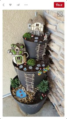 Adorable, fairy garden made from painted pots.