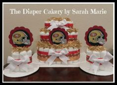 Would like it to be a San Diego Chargers Diaper Cake + mini diaper cakes! #diaper cake #cake #baby shower #gift #centerpiece #matching  #baby
