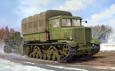 Russian Heavy Tractor Voroshilovets towing a B-4 203mm Howitzer