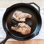 Use tongs to flip the pork chops to the other side. Immediately transfer the skillet to the oven using oven mitts.